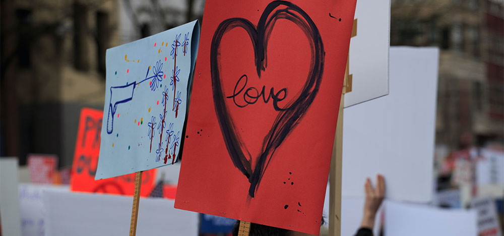 choose love shoot flowers peaceful protest signs
