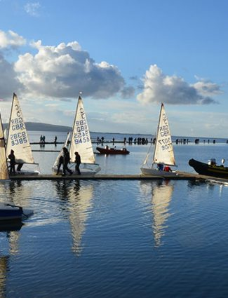 sailboats and reflection on water, collaboration